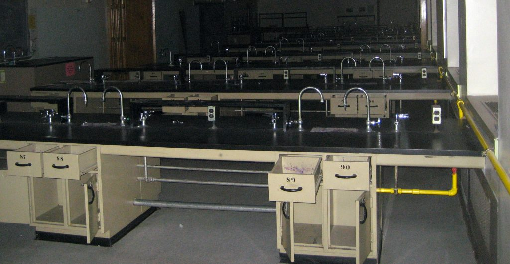 rows of lab benches in an abandoned classroom
